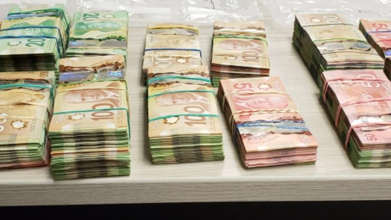 Stacks of Canadian bills in different denominations seized during a Saskatchewan RCMP traffic stop. (Supplied: Saskatchewan RCMP)