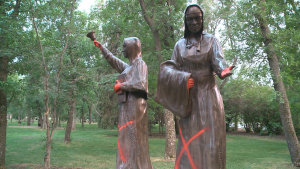 A statue of nuns in Wascana Park was painted red for the second time on July 20, 2021. (Matthew Harris/CTV News)