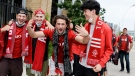 Fans (from left) Ethan Gabor, Nick Nenzel, Zach Ricciuti and Zach Diaz cheer before the start of MLS soccer action between Toronto FC and Orlando City SC, in Toronto, Saturday, July 17, 2021. THE CANADIAN PRESS/Chris Katsarov
