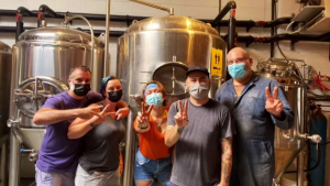 Staff at the People's Pint Brewing Company voluntarily got vaccinated against COVID-19, posting a photo on social media to celebrate the occasion.