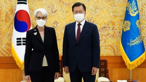 In this photo provided by South Korea Presidential Blue House, South Korean President Moon Jae-in and U.S. Deputy Secretary of State Wendy Sherman, left, pose for photos prior to their meeting at the presidential Blue House in Seoul, South Korea, Thursday, July 22, 2021. (South Korea Presidential Blue House via AP)