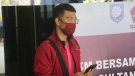 In this July 18, 2021, photo, a man who used a fake identity arrives at the Sultan Babullah airport in Ternate, Indonesia. (AP Photo/Harmoko)