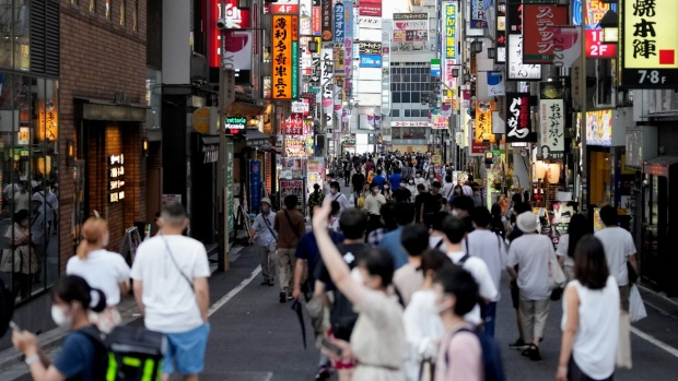 A street is crowded with people in Tokyo's Shinjuku district, on July 22, 2021. (Markus Schreiber / AP)