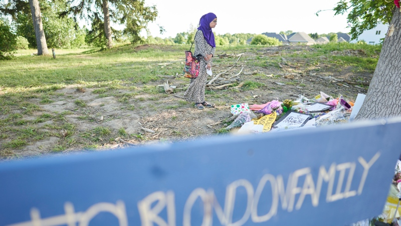 Aruba Mahmud pauses at the memorial for the 4 members of a Muslim family who were run down in a terrorist attack, in London, Ont., Tuesday, June 15, 2021. THE CANADIAN PRESS/Geoff Robins