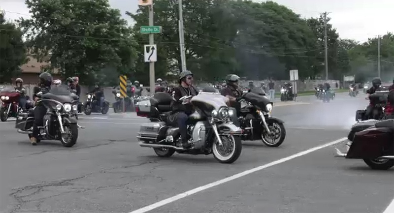 Motorcycles arrive at a rally that followed a memorial for Brandon Marchant outside the Elgin-Middlesex Detention Centre in London, Ont. on Saturday, July 17, 2021. (Jaden Lee-Lincoln / CTV News)