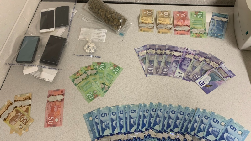 Police in Burnaby, B.C., say a traffic stop for speeding last week led to the seizure of cash, cellphones and drugs, the last of which were stashed in a suspect's underwear. (Twitter/@BurnabyRCMP)