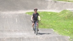 Sam Wheildon, 11, seen biking to raise money for research into a rare genetic mutation. (Peter Szperling/CTV News Ottawa)