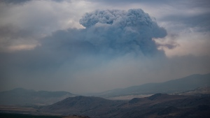 A pyrocumulus cloud, also known as a fire cloud, forms in the sky as the Tremont Creek wildfire burns on the mountains above Ashcroft, B.C., on Friday, July 16, 2021. THE CANADIAN PRESS/Darryl Dyck