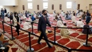 Prime Minister Justin Trudeau arrives at the Hamilton Mountain Mosque to deliver remarks to recognize Eid al-Adha in Hamilton, Ont., Tuesday, July 20, 2021.THE CANADIAN PRESS/Cole Burston