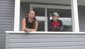 Dawn and Jason Lebrun have been able to purchase their first home, after a decade living in geared-to-income housing. (Photo from video)