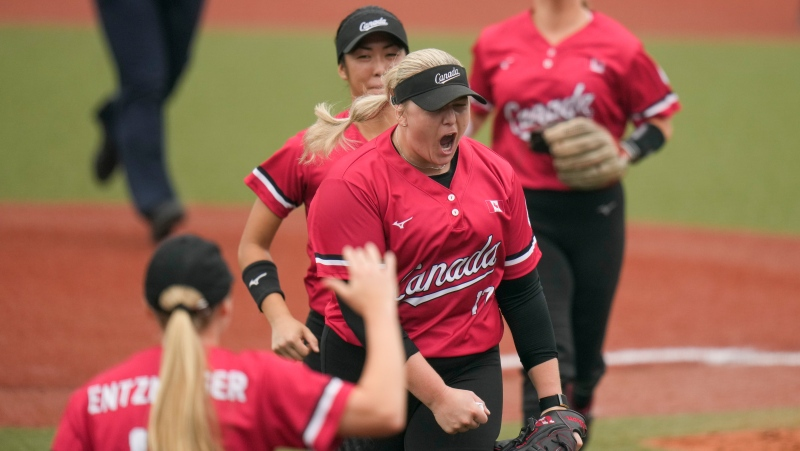 Canada's Sara Groenewegen, centre, celebrates with teammates during the softball game between the United States and Canada at the 2020 Summer Olympics, Thursday, July 22, 2021, in Fukushima , Japan. (AP Photo/Jae C. Hong)