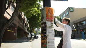 Metropol employee Liam Crocker is shown here setting up posters in downtown Victoria in support of the local arts community: (CTV News)