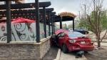 A car was seen outside the patio of a Boston Pizza restaurant in downtown Edmonton Thursday evening (CTV News Edmonton/Brandon Lynch)