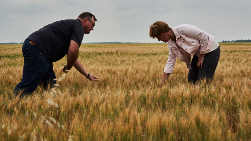 Federal Agriculture Minister Marie-Claude Bibeau speaks with Curtis McRae as she tours his grain farm in the drought-stricken Interlake Region of Manitoba to discuss support measures for Manitoba and Canadian farmers impacted by extreme weather on Thursday July 22, 2021. THE CANADIAN PRESS/David Lipnowski