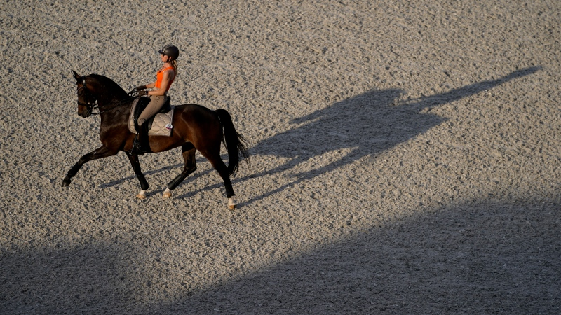 Netherlands' Dinja Van Liere, rides Haute Couture during a training session for the dressage competition at the Equestrian Park at the 2020 Summer Olympics, Thursday, July 22, 2021, in Tokyo, Japan. (AP Photo/Carolyn Kaster)