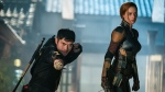 """This image released by Paramount Pictures shows Henry Golding, left, and Samara Weaving in a scene from """"Snake Eyes: G.I. Joe Origins."""" (Niko Tavernise/Paramount Pictures via AP)"""