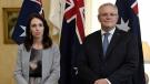 New Zealand Prime Minister Jacinda Ardern, left, stands with Australian Prime Minister Scott Morrison in this Feb. 28, 2020 file photo taken in Sydney. (Bianca De Marchi/Pool Photo via AP)