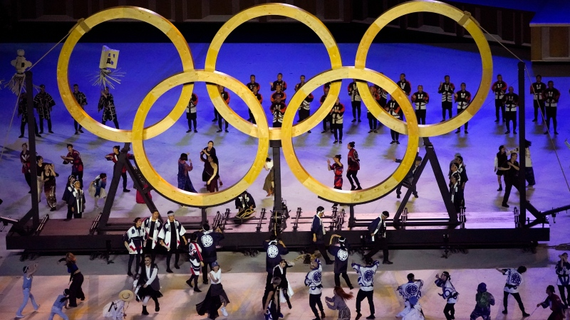 Dancers perform during the opening ceremony in the Olympic Stadium at the 2020 Summer Olympics, Friday, July 23, 2021, in Tokyo, Japan. (AP Photo/Charlie Riedel)