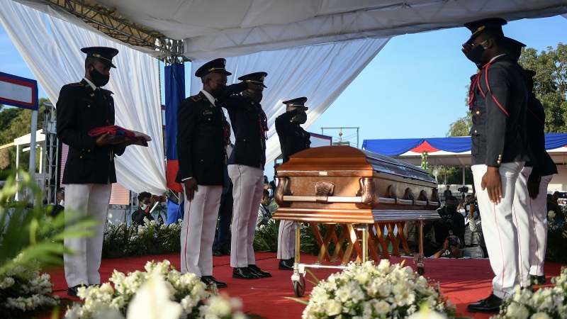 Police stand by the coffin of slain Haitian President Jovenel Moise during his funeral at his family home in Cap-Haitien, Haiti, early Friday, July 23, 2021. Moise was assassinated at his home in Port-au-Prince on July 7. (AP Photo/Matias Delacroix)