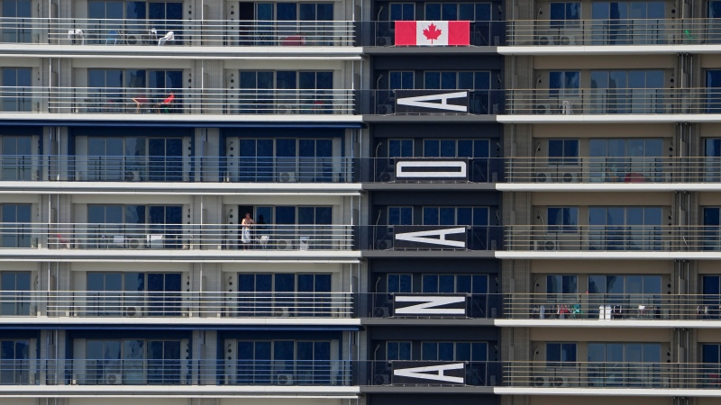 A banner hangs from Canada team apartments in the Olympic athletes' village ahead of the 2020 Summer Olympics, July 19, 2021, in Tokyo. (AP Photo/Charlie Riedel)