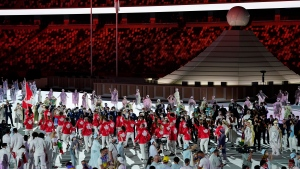 Canada marches into the stadium during the opening ceremony in the Olympic Stadium at the 2020 Summer Olympics, Friday, July 23, 2021, in Tokyo, Japan. (AP Photo/Ashley Landis)