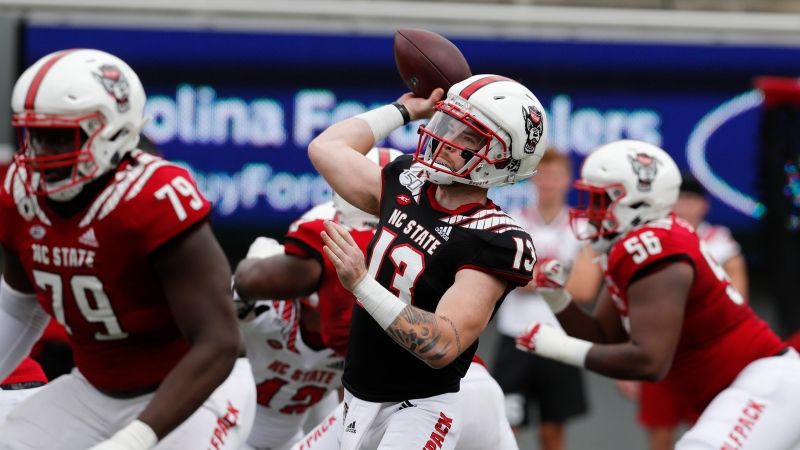 North Carolina State quarterback Devin Leary (13) throws a pass during the first half of the team's spring NCAA college football game at Carter-Finley Stadium in Raleigh, N.C., Saturday, April 10, 2021. (Ethan Hyman/The News & Observer via AP)