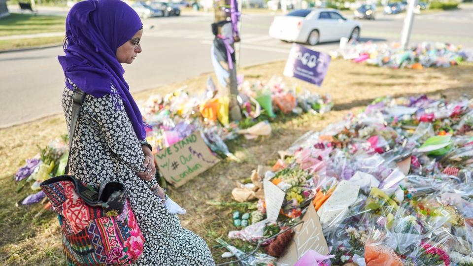 Aruba Mahmud at memorial for Muslim family