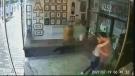 Couple accidentally smashes through business windo
