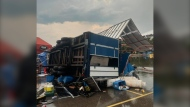 A Queen City Ribfest trailer is seen flipped on its side following a significant storm on July 22, 2021. (Source: Queen City Ribfest/Facebook)