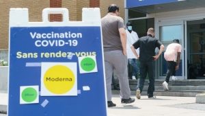 People enter a COVID-19 vaccination clinic in Montreal, on Thursday, July 22, 2021. THE CANADIAN PRESS/Paul Chiasson