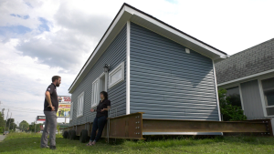 Andrew Melchers, left, and Heather Brisebois discuss their options on a final destination for the tiny home. (Nate Vandermeer/CTV News Ottawa)