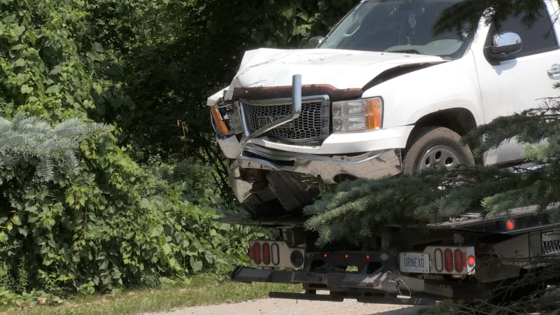 A pickup truck was pulled from a wooded area following an incident in Woodstock, Ont. on Friday, July 23, 2021. (Jim Knight / CTV News)