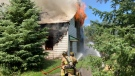 Firefighters at the scene of a house fire on Malakoff Road on Friday, July 23, 2021. (Ottawa Fire Services)
