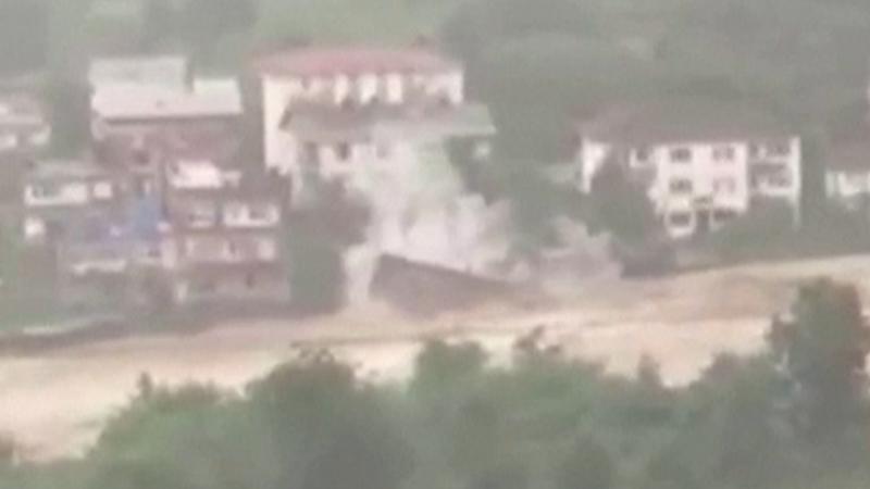 Flood waters sweep away home in Turkey