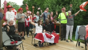 Sandy and Gus Ayim are surrounded by family and friends in London, Ont. as they cheer their daughter Miranda Ayim on Friday, July 23, 2021. (Marek Sutherland / CTV News)
