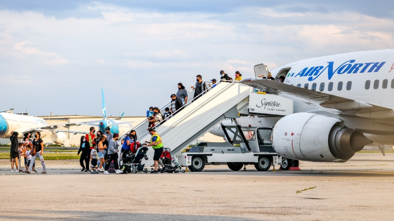 Northwestern Ontario residents arrive at Toronto Pearson International Airport. CTV/Tom Podolec.