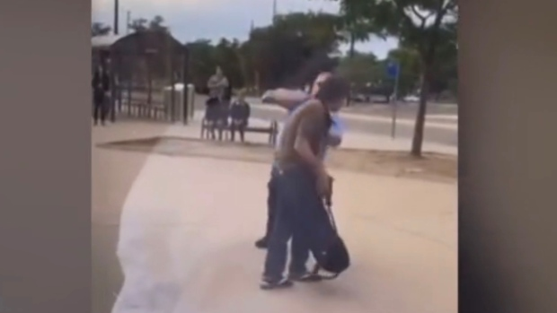 This image taken from video appears to show a London, Ont. transit driver punch another man. (Source: Divyasri Sreekuma)