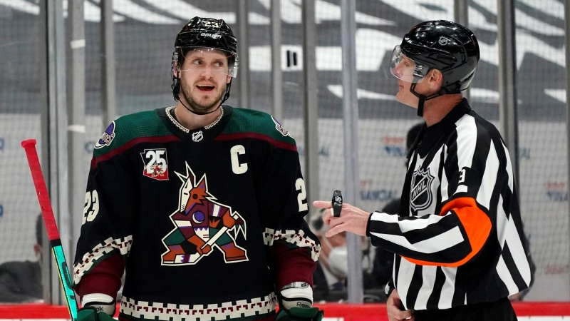 Arizona Coyotes defenseman Oliver Ekman-Larsson (23) argues with referee Dan O'Rourke after a penalty was called against the Coyotes during overtime of an NHL hockey game against the Vegas Golden Knights on Saturday, May 1, 2021, in Glendale, Ariz. (AP / Ross D. Franklin)