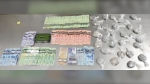 EPS seized nearly $175,000 worth of fentanyl and a firearm in a downtown Edmonton residence on Thursday, July 22, 2021. (Supplied)