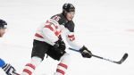 Canada's Owen Power in action during the Ice Hockey World Championship final match between Finland and Canada at the Arena in Riga, Latvia, Sunday, June 6, 2021. (AP Photo/Sergei Grits)