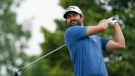 Adam Hadwin hits a tee shot off the seventh hole during the second round of the 3M Open golf tournament in Blaine, Minn., Friday, July 23, 2021. (AP Photo/Craig Lassig)