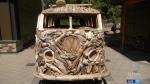 Driftwood replica of van drawing eyes in Tofino