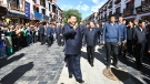 In this July 22, 2021 photo released by China's Xinhua News Agency, Chinese President Xi Jinping, centre, visits Barkhor Street near the Jokhang Temple in Lhasa in western China's Tibet Autonomous Region. (Xie Huanchi/Xinhua via AP)