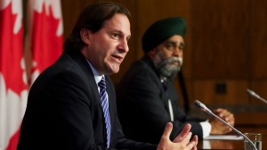 Immigration Minister Marco Mendicino, left, is joined by Harjit Sajjan, Minister of National Defence hold a press conference in Ottawa on Friday, July 23, 2021. THE CANADIAN PRESS/Sean Kilpatrick
