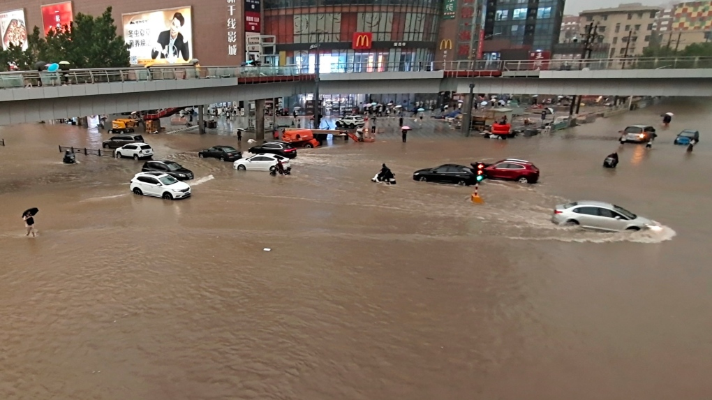 Vehicles stranded in China flooding