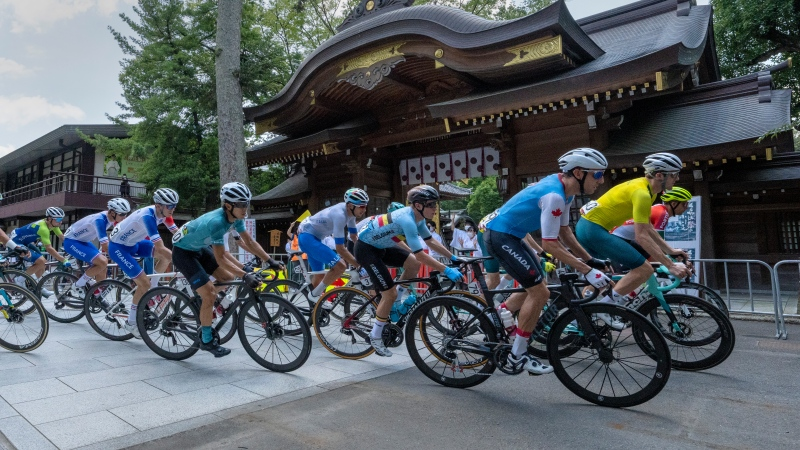 Michael Woods (79) of Canada rounds a corner in front of the Okunitama Shrine in the Men's Cycling Road Race at the Tokyo Olympics in Tokyo, Japan on Saturday, July 24, 2021. THE CANADIAN PRESS/Frank Gunn
