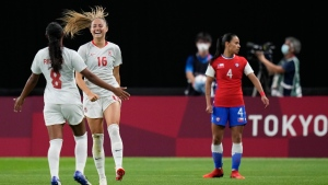 Canada's Janine Beckie, second left, celebrates scoring her side's 2nd goal during a women's soccer match against Chile at the 2020 Summer Olympics, Saturday, July 24, 2021, in Sapporo, Japan. (AP Photo/Silvia Izquierdo)