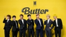 """Members of South Korean K-pop band BTS pose for photographers ahead of a press conference to introduce their new single """"Butter"""" in Seoul, South Korea, Friday, May 21, 2021. (AP Photo/Lee Jin-man)"""