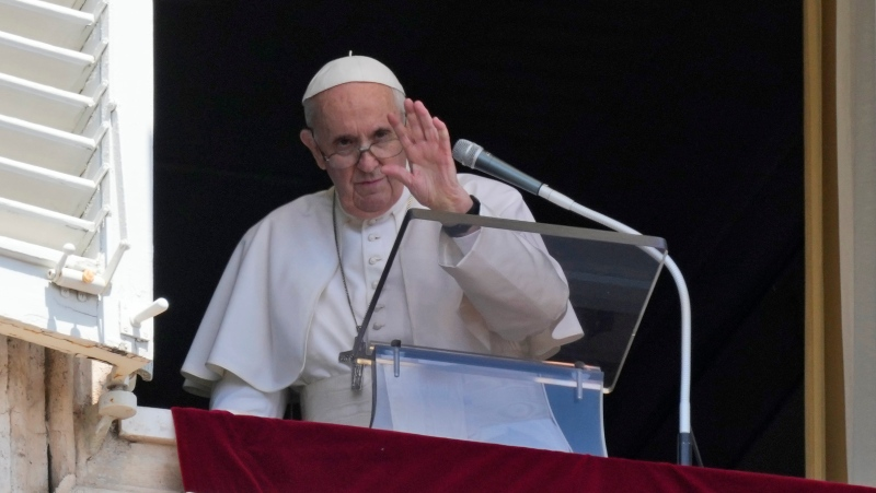 Pope Francis waves to the crowd as he leaves after delivering the Angelus noon prayer from the window of his studio overlooking St.Peter's Square, at the Vatican, Sunday, July 18, 2021. (AP Photo/Alessandra Tarantino)