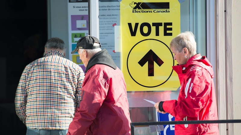 People arrive to cast their ballots at a polling station on federal election day in Shawinigan, Que., Monday, Oct. 21, 2019. THE CANADIAN PRESS/Graham Hughes